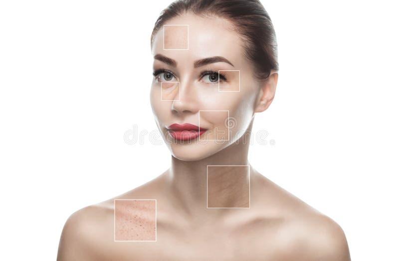Ståenden av en härlig kvinna på en vit bakgrund, på framsidan är synliga områden av problemhud - skrynklor och fräknar arkivbilder