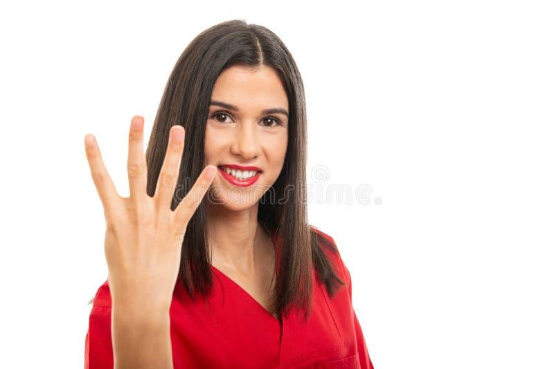 St?enden av h?rligt b?ra f?r sjuksk?terska som ?r r?tt, skurar uppvisning av gest f?r nummer fyra arkivbild