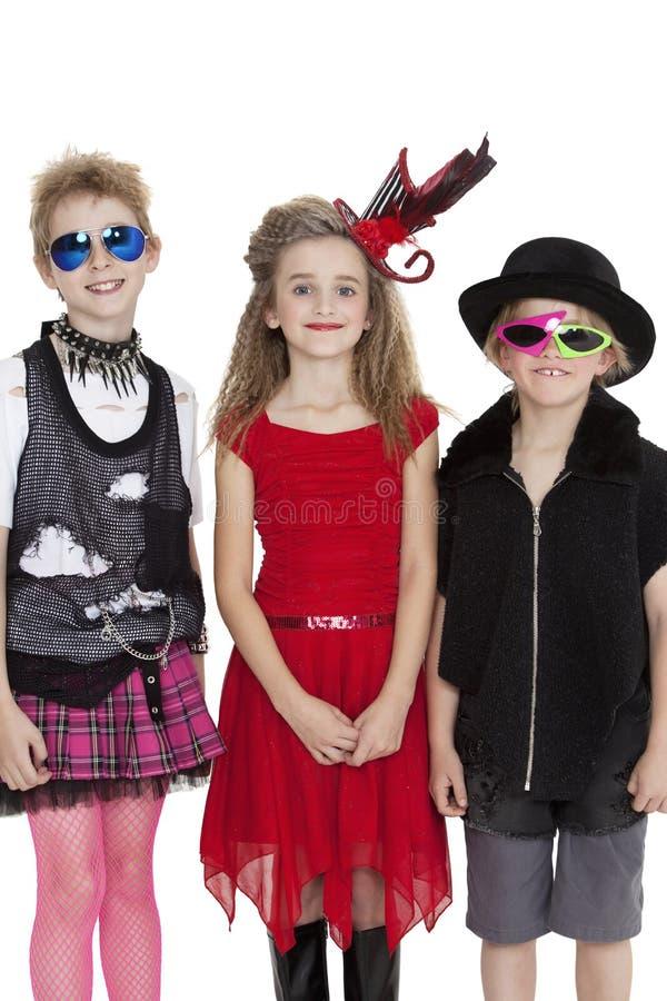 Ståenden av skolbarn som bär maskeradkläderna, utrustar över vit bakgrund royaltyfri fotografi