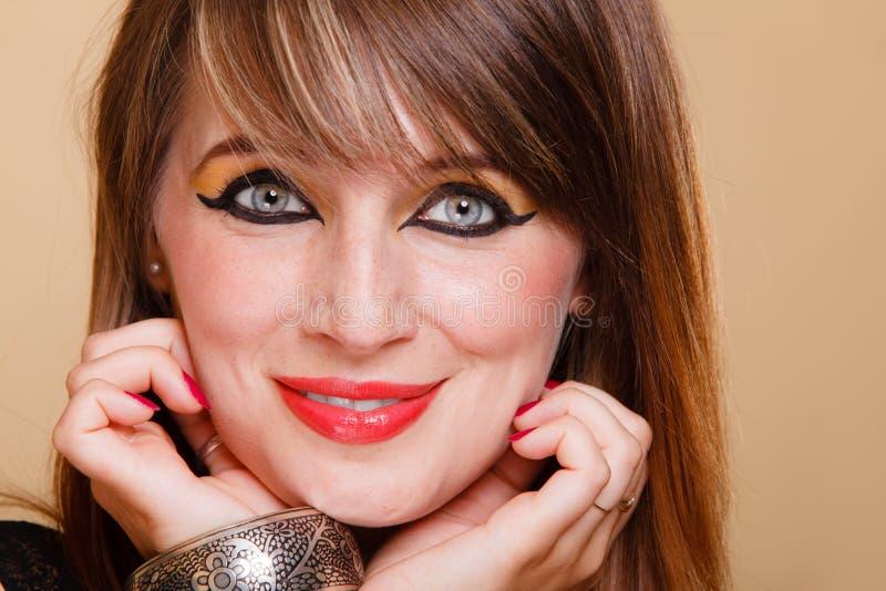 StåendeOrient flicka med makeup arkivfoto