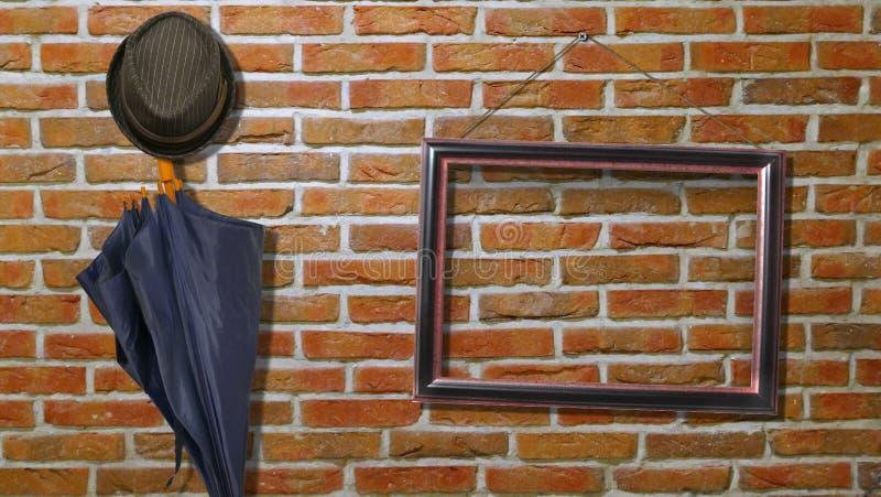 Ståenderam på en tegelstenvägg arkivfoto