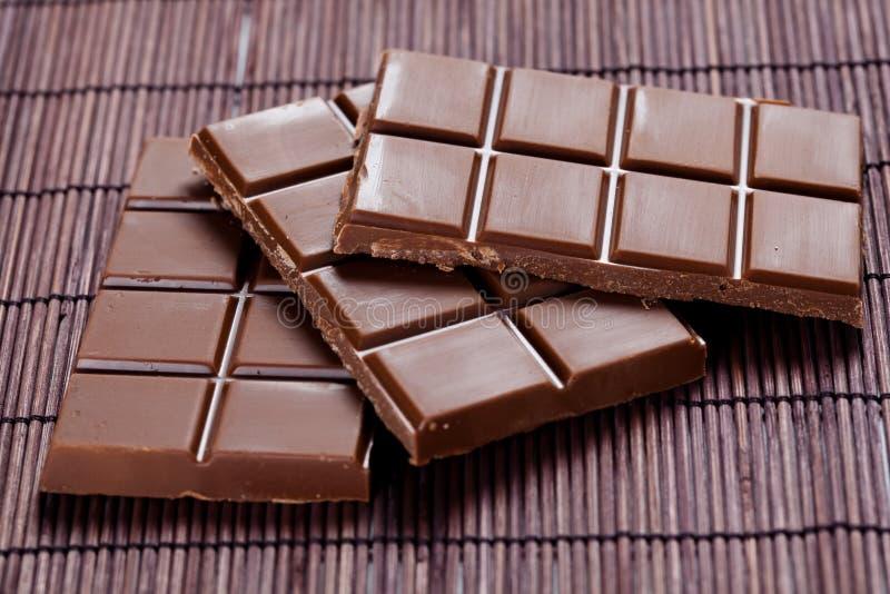 stångchoklad mjölkar smakligt royaltyfri bild