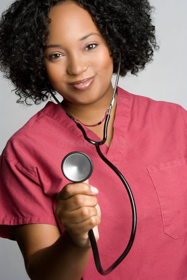 Stéthoscope de fixation d'infirmière photo stock