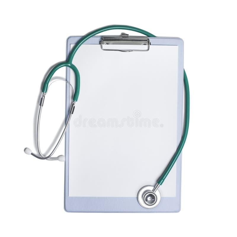 Stéthoscope et formule en blanc photographie stock