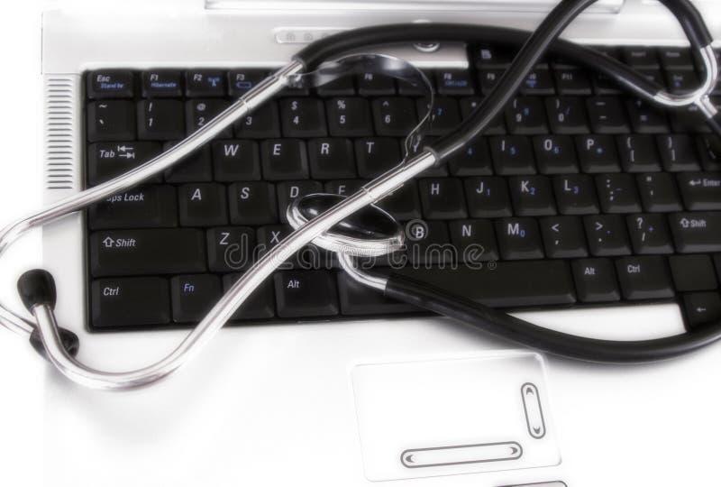 Stéthoscope sur le clavier photo stock