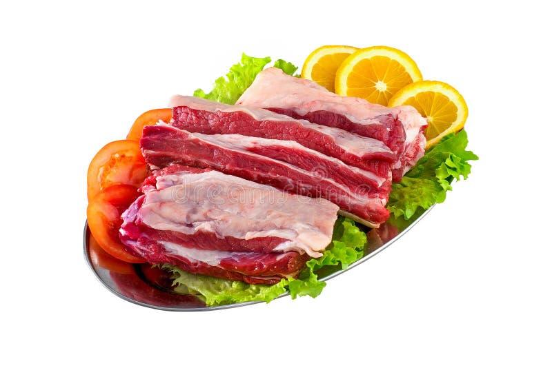 Stöd och fläskkotletter för nytt och rått kött som isoleras på den vita backgroen arkivfoton