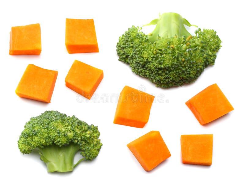 Stück des Kürbises mit dem Brokkoli lokalisiert auf Draufsicht des weißen Hintergrundes lizenzfreies stockbild