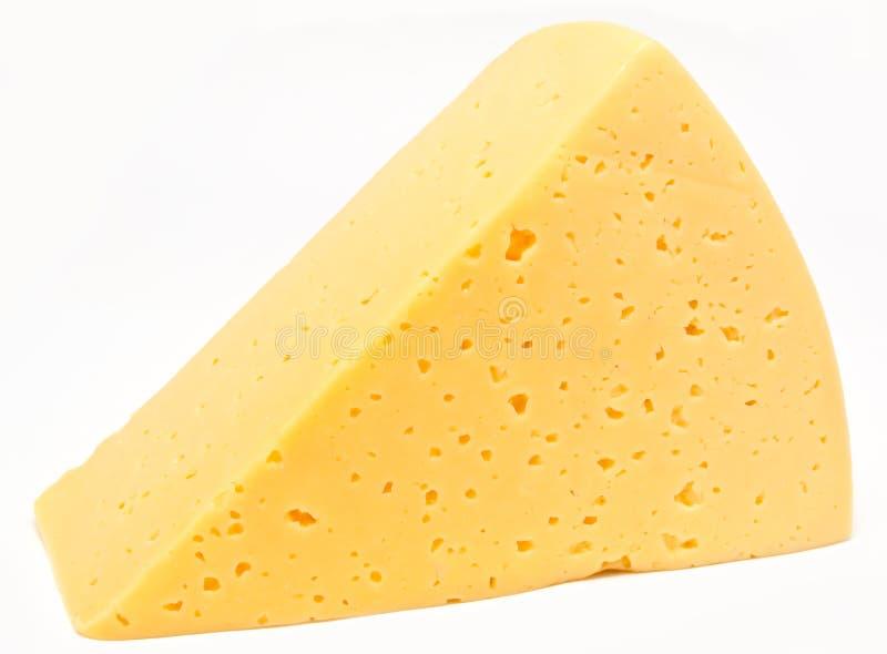 Stück Käse getrennt auf Weiß lizenzfreie stockfotos