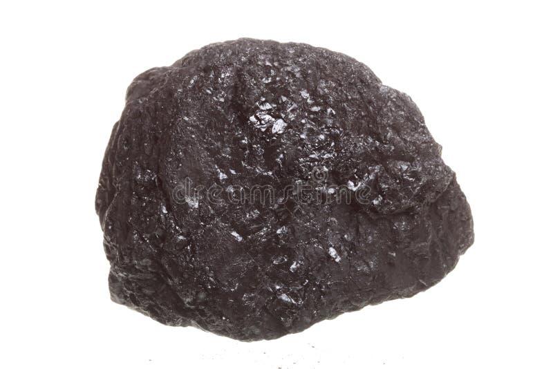 Stück Kohle lokalisiert auf Weiß stockfotografie