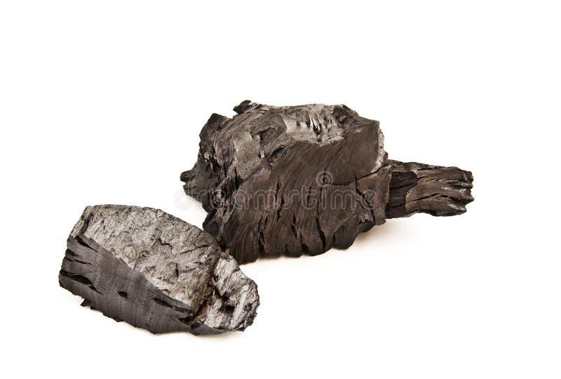 Stück zerbrochene hölzerne Kohle lokalisiert lizenzfreie stockfotos