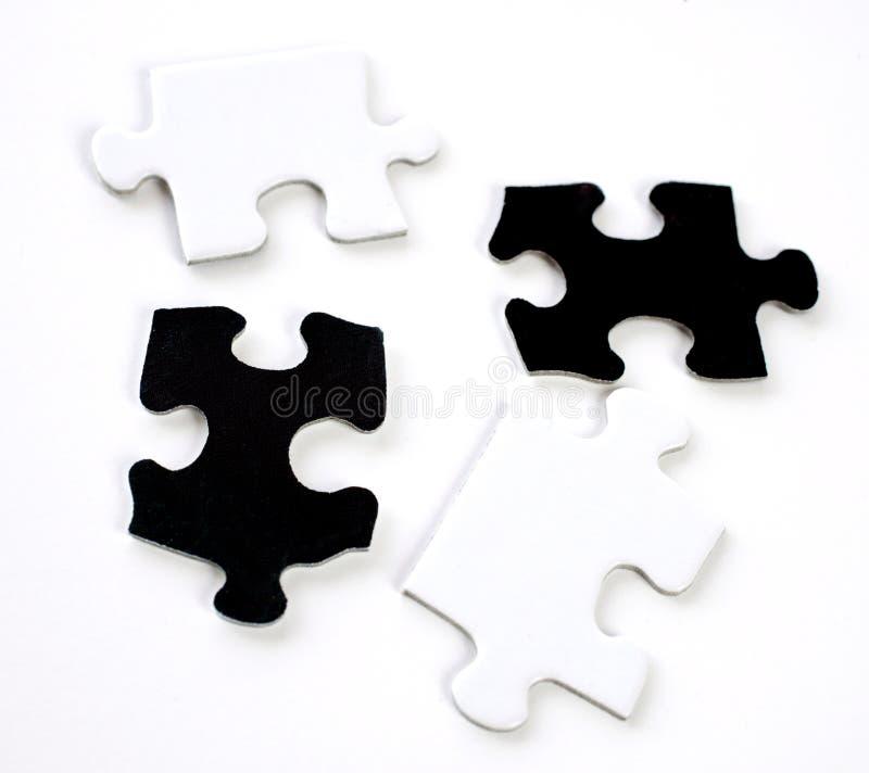 Stücke eines Puzzlespiels stockfoto