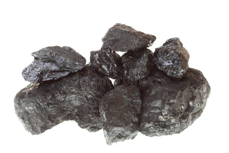 Stücke Kohle lokalisiert auf weißem Hintergrund stockbilder