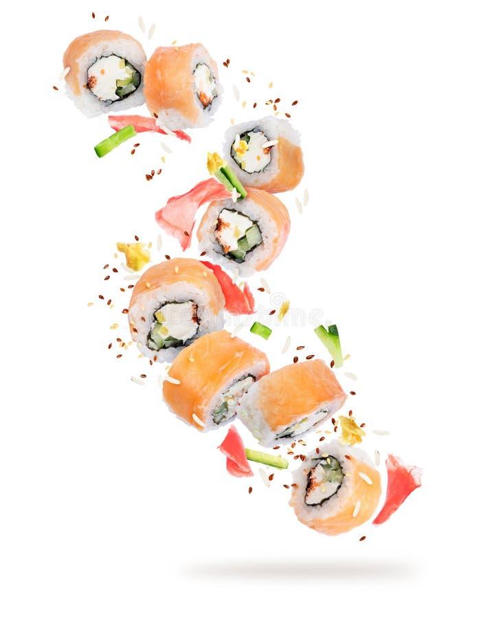 Stücke Sushi eingefroren in der Luft in der hohen Auflösung lizenzfreie stockfotografie