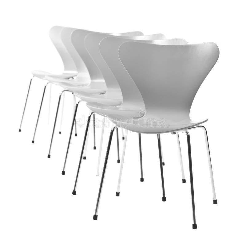 Stühle in einer Reihe stockbilder