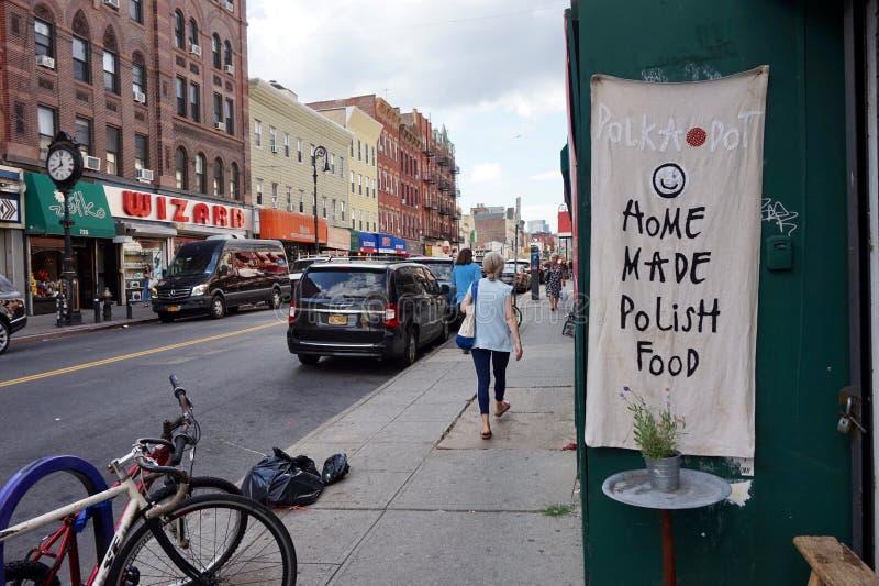 St Манхэттена, Бруклин, NY - знак ресторана точки польки стоковые фотографии rf