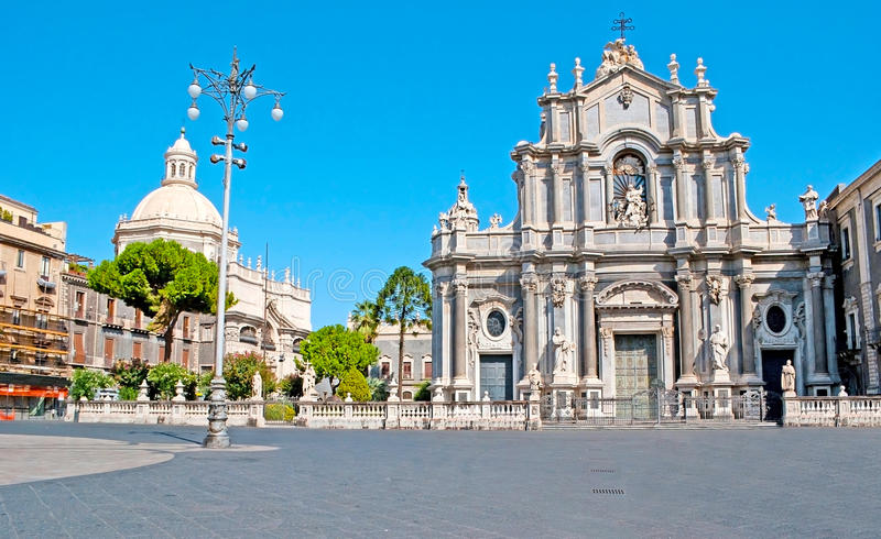 St Agatha Cathedral of Catania. The Baroque building of St Agatha Cathedral, decorated with the stone sculptures, located in the central city square - Duomo stock image