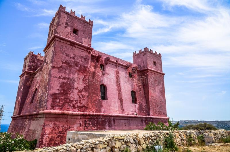 St Agatha`s Red Tower in Melieha, Malta. Saint Agatha`s Tower, or Torri l-Aħmar in Maltese, is situated at the Marfa Ridge and overlooks Mellieha Bay in the stock image