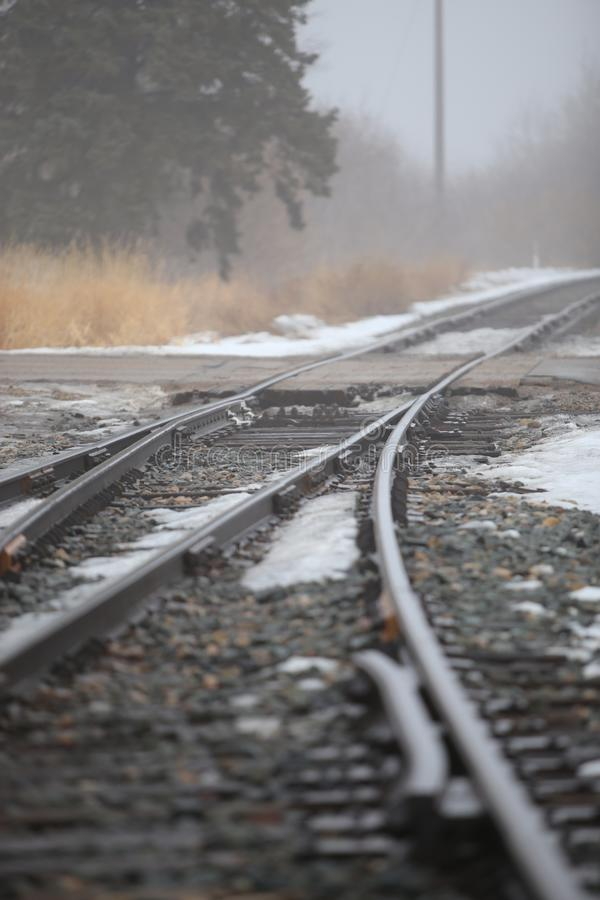 St.Albert, Alberta, Canadian foggy winter day on snowy train track. royalty free stock photo
