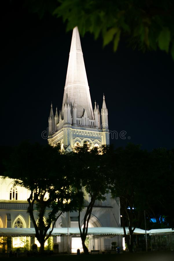 St. Andrew& x27;s Cathedral illuminated in Singapore at night. Building, church, tower, anglican, arch, architecture, asia, asian, beautiful, christian, city stock images