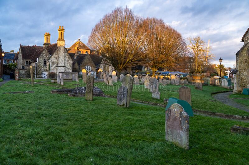 St Andrew`s Church Backyard with cemetery. Anglican parish church in the center of Farnham, Surrey, England royalty free stock images