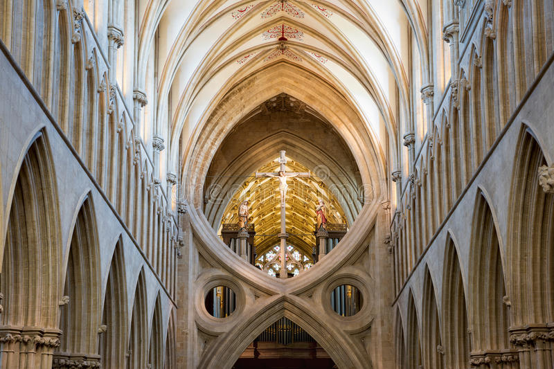 St Andrew`s Cross arches in Wells cathedral. Wells, United Kingdom - August 6, 2016: St Andrew`s Cross arches under the tower inside Wells Cathedral royalty free stock image
