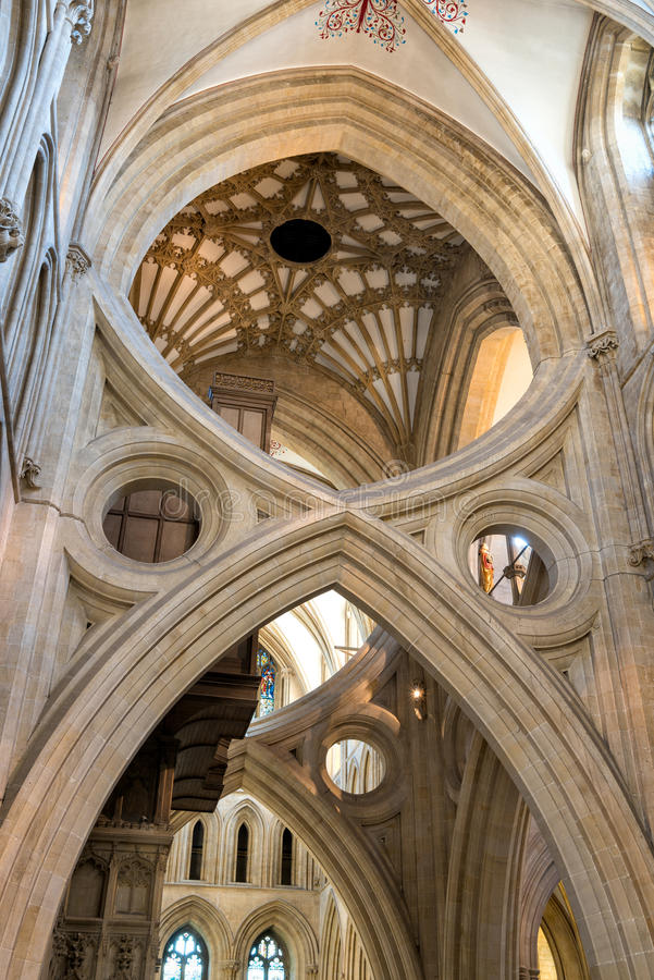St Andrew`s Cross arches in Wells cathedral. Wells, United Kingdom - August 6, 2016: St Andrew`s Cross arches under the tower inside Wells Cathedral royalty free stock photography