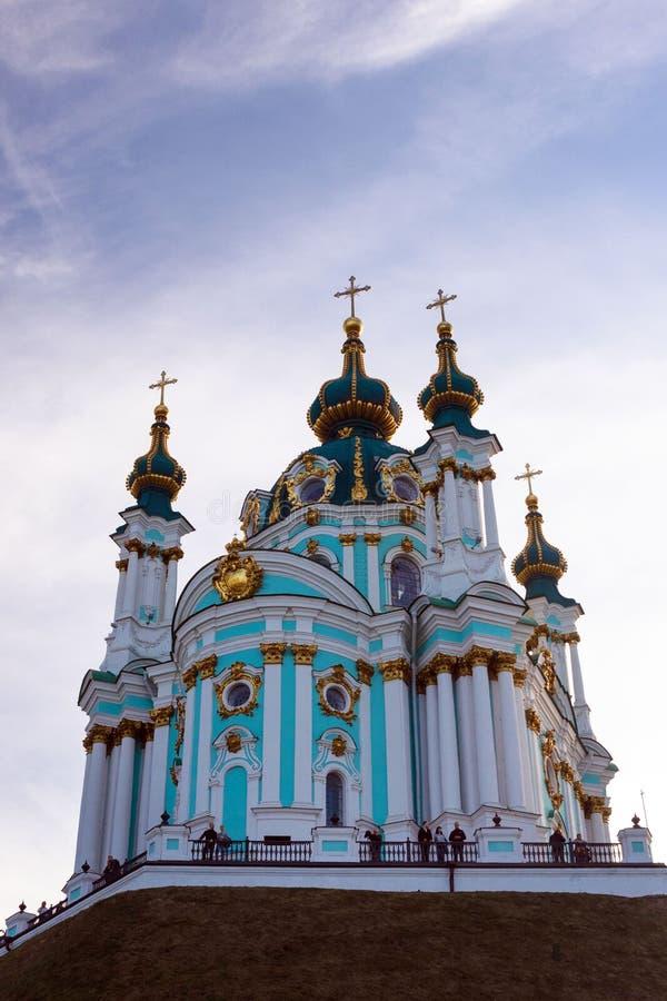 St. Andrew`s Orthodox Church on St. Andrew`s Uzvoz in the Ukrainian capital, Kiev. Golden domes against the blue sky stock photos