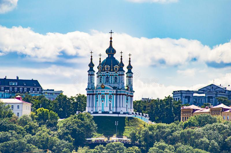St. Andrew`s Orthodox Ukrainian Church on the hills of Kiev under the clouds royalty free stock images
