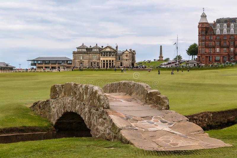St Andrews Golf Course Scotland. The 1st & 18th hole and famous Swilcan Bridge of St Andrews golf course, Fife Scotland royalty free stock image