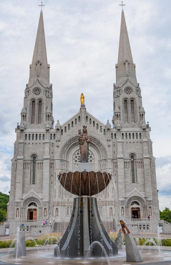 Front of the Basilica of Sainte-Anne-de-Beaupré church in Quebec Canada with statues and a fountain stock photography