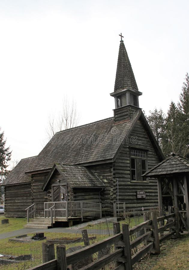 St.Anne`s Anglican old log Church Parksville, BC. Parksville is a city on Vancouver Island, in British Columbia, Canada. Beautiful beaches covered with driftwood royalty free stock image
