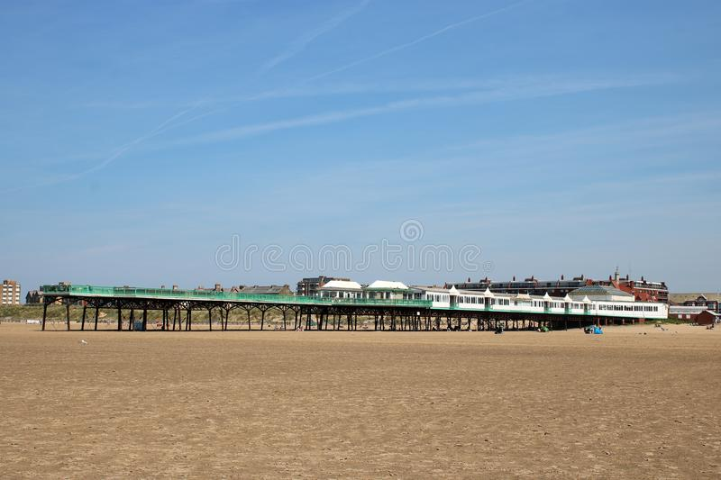 St Anne`s pier from beach at St Anne`s-on-the-Sea stock photo