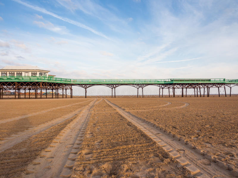 St annes pier. St Annes, Lancashire, UK. June 15th 2015. The pier at St Annes at low tide royalty free stock photos