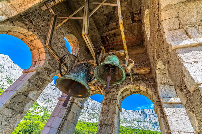 St. Anthony church tower bells. View from the St. Anthony church bell tower in old village Tucepi in Dalmatia royalty free stock photos