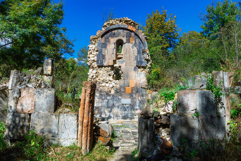 St. Astvatsatsin Holy Mother of God Church ruins in Aghveran. Ruins of St. Astvatsatsin Holy Mother of God Church in Aghveran on the Tsakhkuniats mountain built royalty free stock image