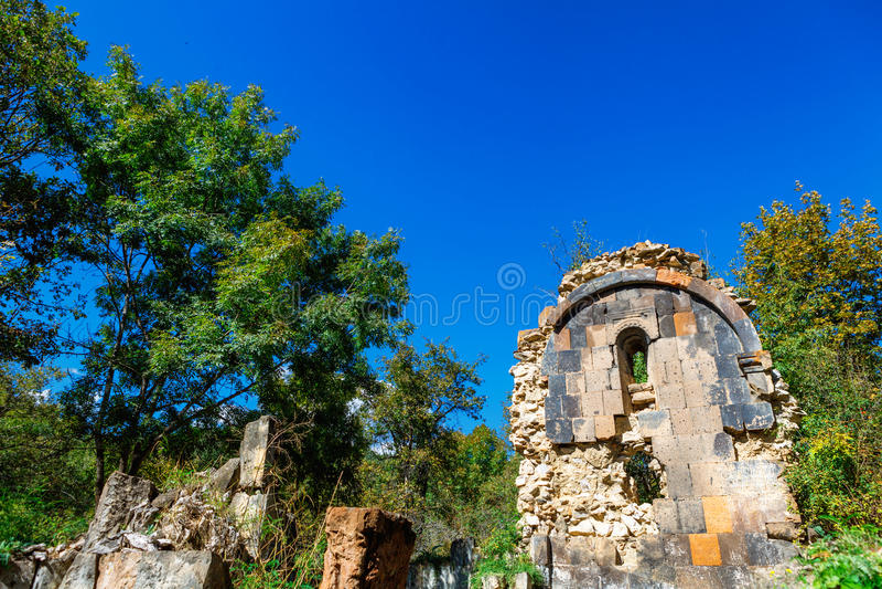 St. Astvatsatsin Holy Mother of God Church ruins in Aghveran. Ruins of St. Astvatsatsin Holy Mother of God Church in Aghveran on the Tsakhkuniats mountain built stock photo