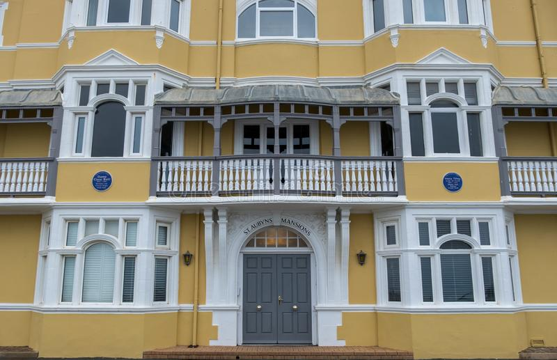 St Aubyns Mansions on Kings Esplanade, Hove, East Sussex, UK. Restored mustard coloured block of flats overlooking the sea royalty free stock photos