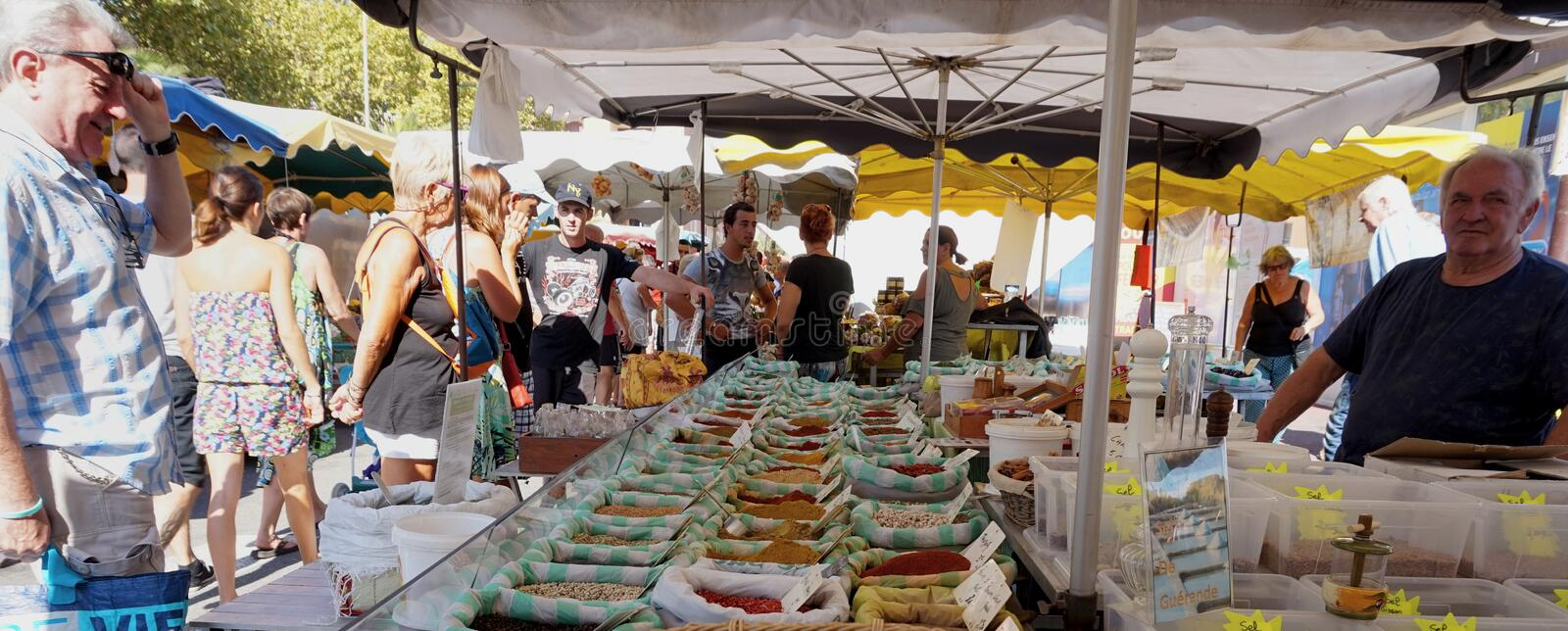 St AYGULF, VAR, PROVENCE, FRANCE, AUGUST 26 2016: Provencal market stall selling fresh loose spices and other items to locals and stock photo