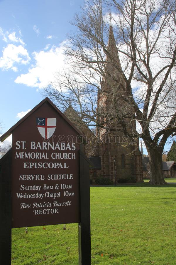 St. Barnabas Memorial Church, Falmouth, Massachusetts, United States. The landmark stone church in the scenic town of Falmouth, with tall steeple and cross on royalty free stock photo