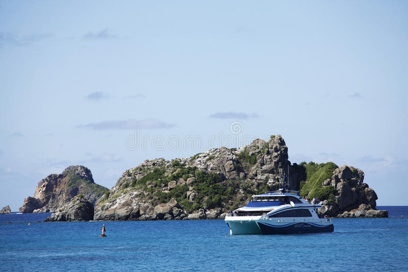 Speed boat Voyager arriving to St. Barths marina from St. Martin stock image