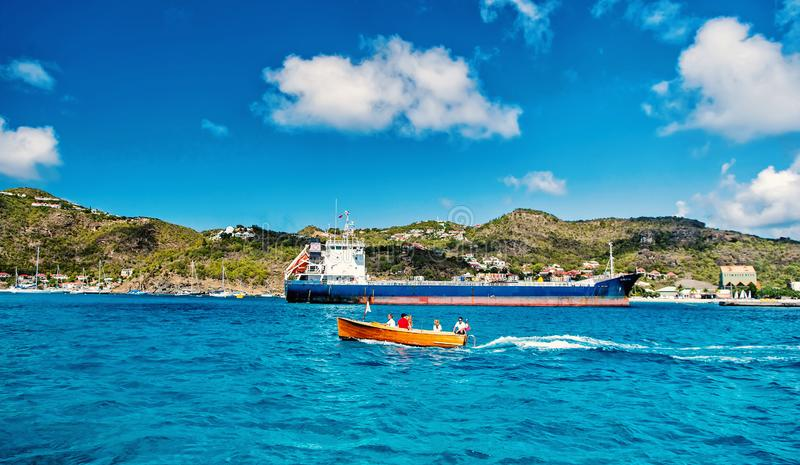 People in boat, big cargo ship, French island, Saint Barth lemy stock photos