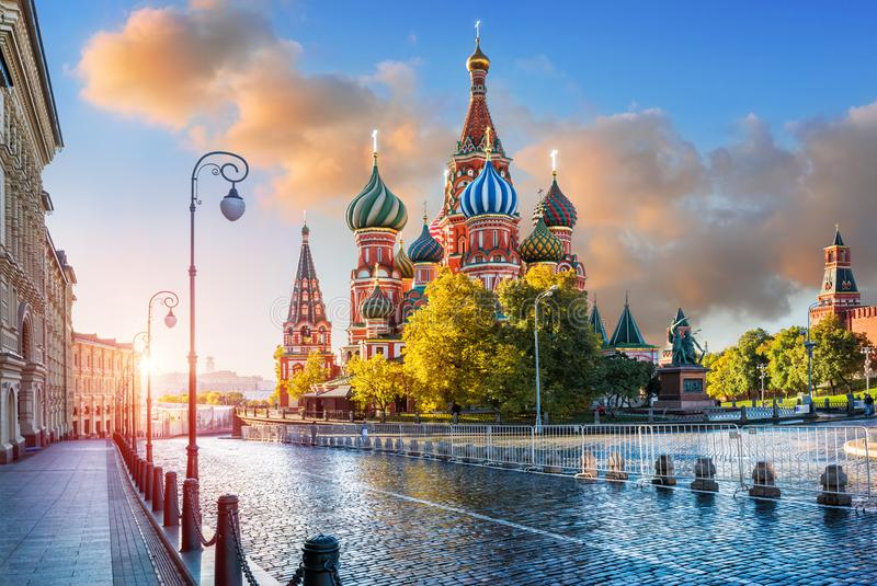 St. Basil`s Cathedral with lanterns on Red Square. In Moscow in the light of morning sunlight and pink clouds in the sky stock image