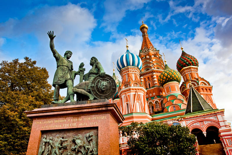 St. Basil's Cathedral and Minin and Pozhardky monument in Moscow royalty free stock images