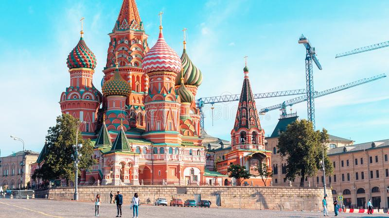 St. Basil`s Cathedral on Red Square with tourists in fron of it. MOSCOW, RUSSIA - July 26, 2017: St. Basil`s Cathedral on Red Square with tourists in fron of it stock images