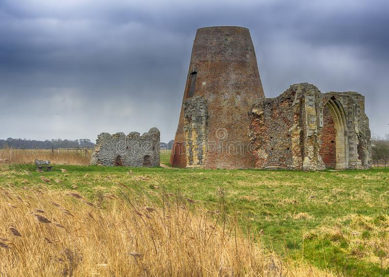 St Benet`s Abbey gatehouse and mill on the Norfolk Broads during a winter storm. stock photography
