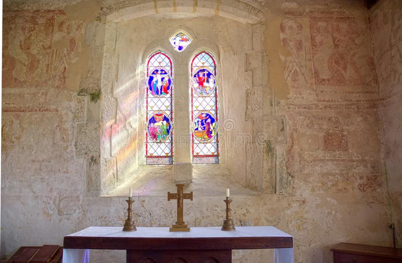 St Botolphs, Interior Frescoes. 11th century Church, Hardham. Sussex, Uk. St Botolphs Church in Hardham, Sussex, UK contains the earliest nearly complete series royalty free stock image