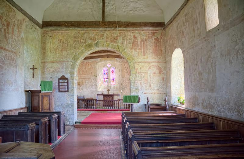 St Botolphs, Interior Frescoes. 11th century Church, Hardham. Sussex, Uk. St Botolphs Church in Hardham, Sussex, UK contains the earliest nearly complete series stock photo