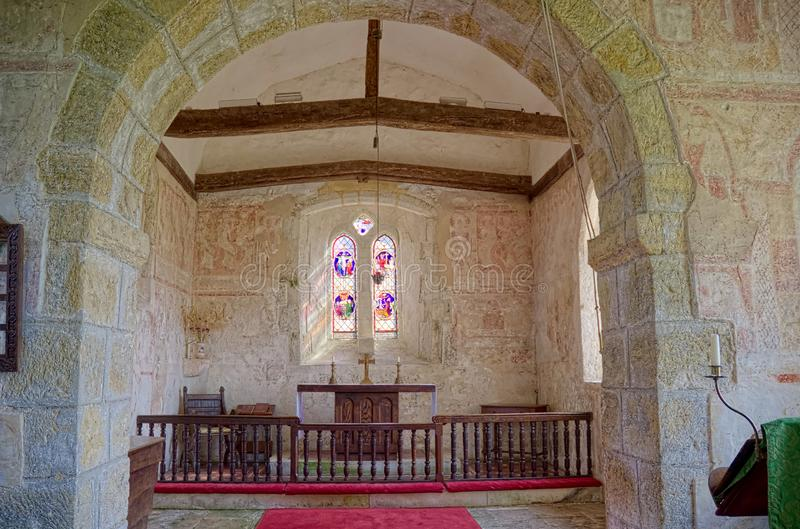 St Botolphs, Interior Frescoes. 11th century Church, Hardham. Sussex, Uk. St Botolphs Church in Hardham, Sussex, UK contains the earliest nearly complete series stock image