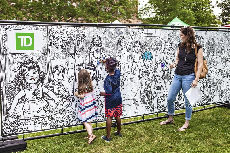 ST.Catharines/Canada/07-21-2019 THE TD NIAGARA JAZZ FESTIVAL,  children draw on the wall in the park. A group of children performs African folk music musical stock photo