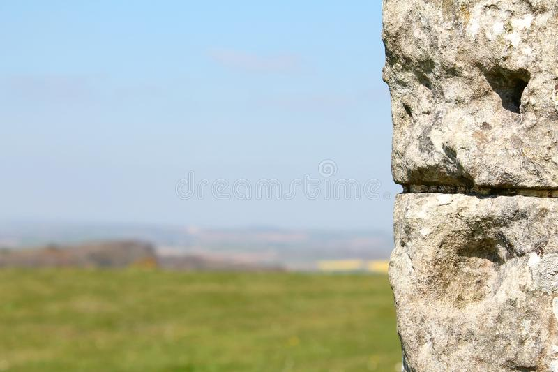 St Catherine`s Oratory, Isle of Wight, UK. View of part of wall with field in background at St Catherine`s Oratory with blue sky on the Isle of Wight, UK royalty free stock image